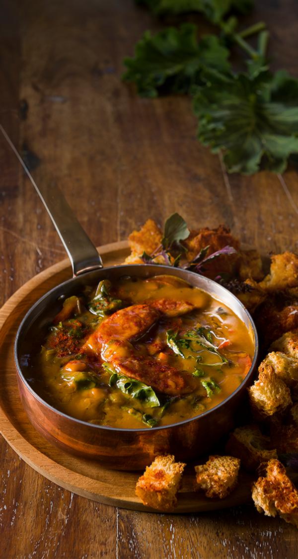 Chakalaka Soup with Chorizo, Spinach and Paprika-Spiced Croutons
