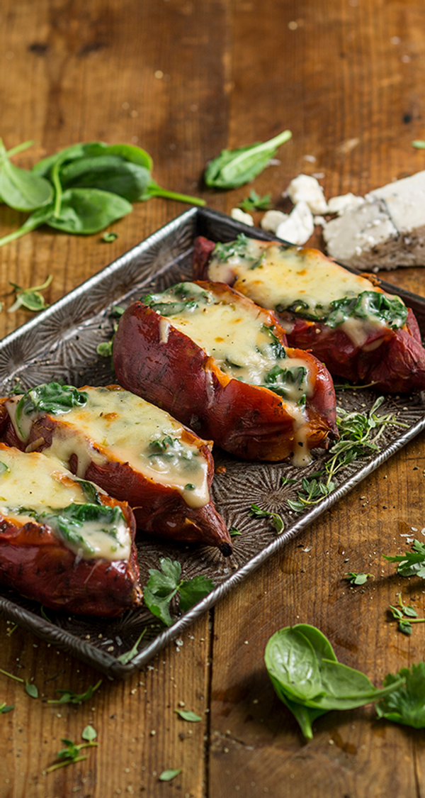Baked Sweet Potato with Three Cheese Sauce and Spinach
