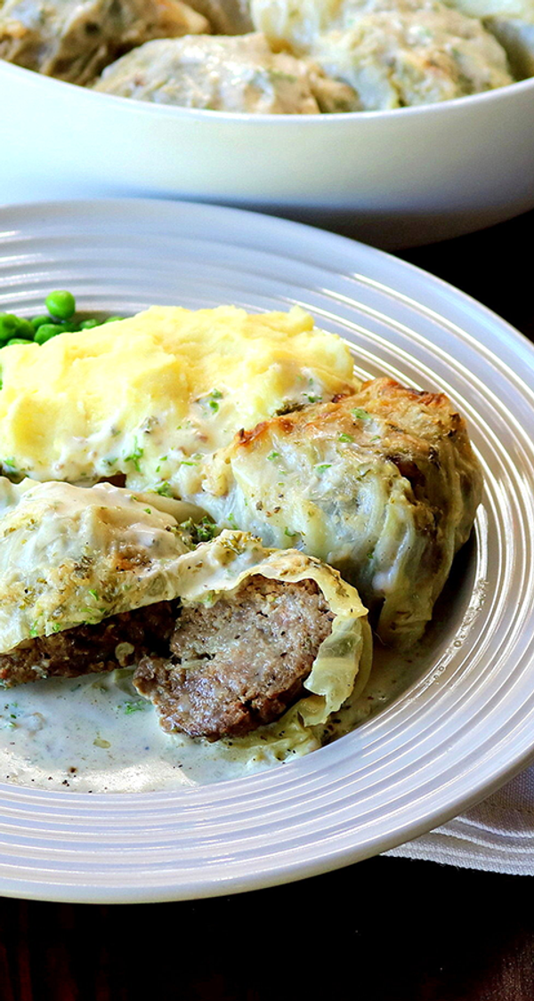 Cabbage Wrapped Meatballs in a Creamy Onion Sauce