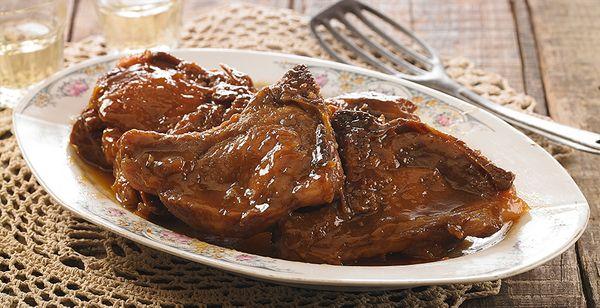 Bisteca de Porco com Molho de Pêssego